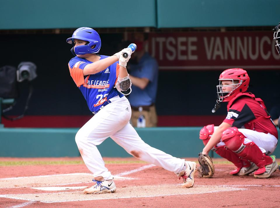Michigan third baseman Jackson Surma hits a two-run double in the first inning against Ohio during the Little League World Series championship game.
