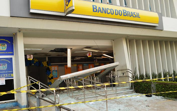 The bank that was broken into in Cameta, with the front of the building blown off - AFP
