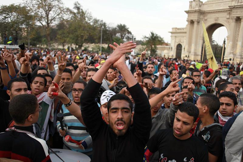 Hundreds of Islamist demonstrators outside of Qobba Palace chant slogans defying a new protest law that has drawn widespread criticism from the international community and democracy advocates, shortly before Egyptian riot police fired tear gas to disperse the protest in Cairo, Egypt, Friday, Nov. 29, 2013.(AP Photo/Sabry Khaled, El Shorouk Newspaper) EGYPT OUT