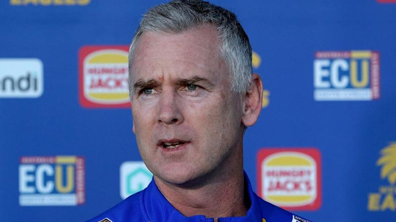 Eagles officials haven't decided who will join coach Adam Simpson in Queensland for the AFL restart