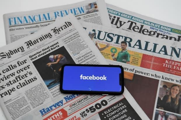 Australia's Parliament on Thursday passed the final amendments to the so-called News Media Bargaining Code that forces Google and Facebook to pay for news. Last week, Canadian Heritage Minister Steven Guilbeault said Canada would introduce its own rules in the coming months.  (Lukas Coch/AAP/Reuters - image credit)