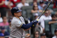 Milwaukee Brewers' Willy Adames (27) gets a base hit during the first inning of Game 3 of a baseball National League Division Series against the Atlanta Braves, Monday, Oct. 11, 2021, in Atlanta. (AP Photo/John Bazemore)