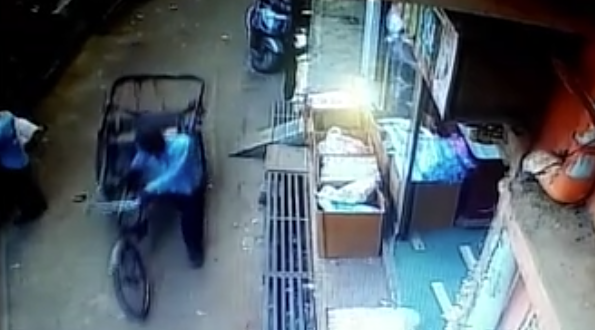 The rickshaw driver is seen in CCTV footage going through a bus street. (Caters)