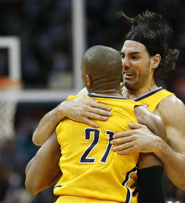 Indiana Pacers forward David West (21) celebrates with teammate Luis Scola (4) after hitting a basket late in the second half of Game 4 of an NBA basketball first-round playoff series against the Atlanta Hawks, Saturday, April 26, 2014, in Atlanta. The Pacers won 91-88 to even the series at two games apiece. (AP Photo/John Bazemore)