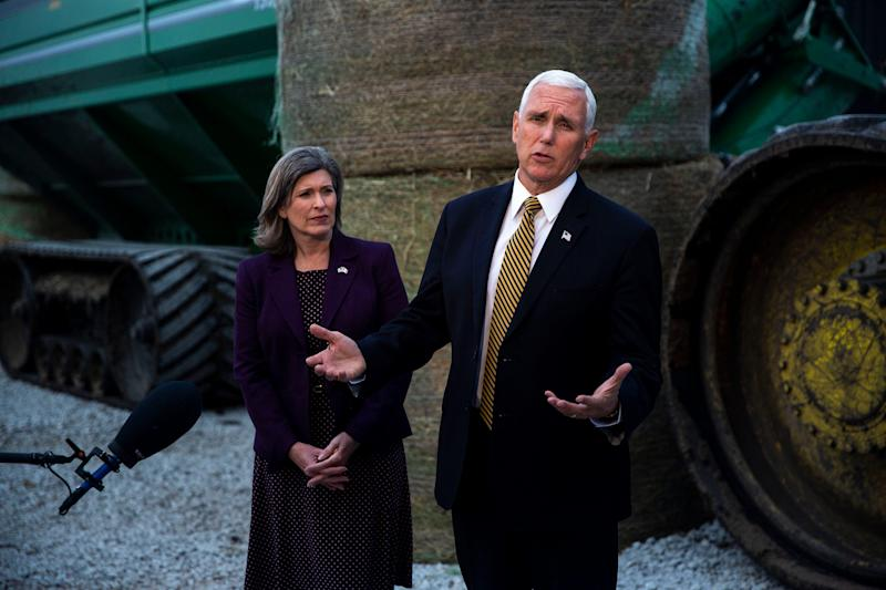 Vice President Mike Pence and U.S. Sen. Joni Ernst, R-Red Oak, answers questions from the press after speaking at an America First Policies event on Wednesday, Oct. 9, 2019, at Manning Farms in Waukee.