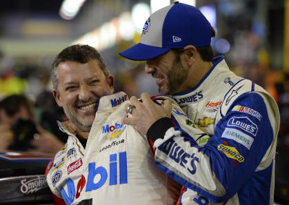 HOMESTEAD, FL - NOVEMBER 18: Tony Stewart (L), driver of the #14 Always a Racer/Mobil 1 Chevrolet, and Jimmie Johnson, driver of the #48 Lowe\
