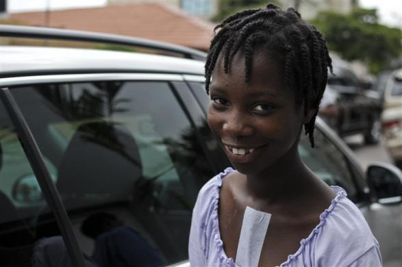 Haitian girl Fabien Destine, 14, smiles after her checkup a week after the operation to close a hole in the wall of her heart chambers, in Port-au-Prince April 28, 2012.
