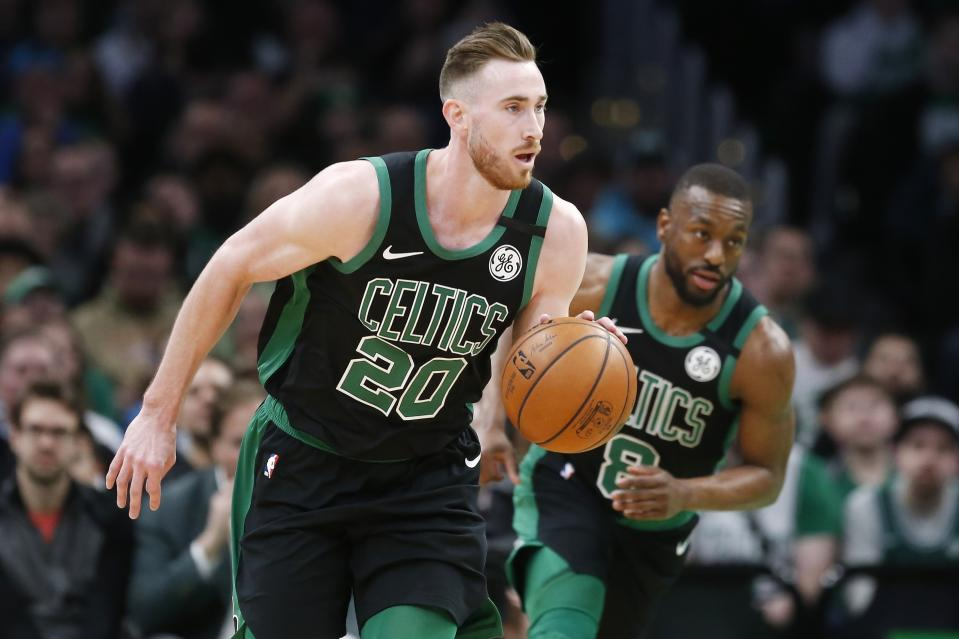 Boston Celtics' Gordon Hayward (20) and Kemba Walker (8) plays against the Oklahoma City Thunder during the first half of an NBA basketball game, Sunday, March, 8, 2020, in Boston. (AP Photo/Michael Dwyer)