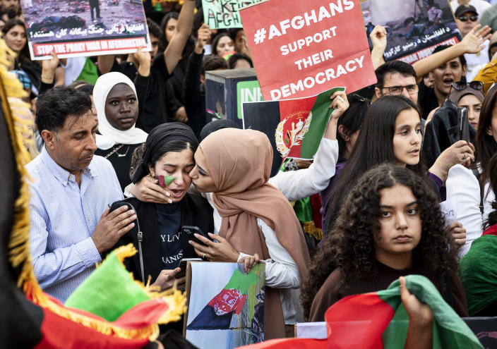In front of the US Embassy, protesters demonstrate in support of Afghan people, in Copenhagen, Denmark, Sunday Aug. 22, 2021. After the demonstration in front of the Pakistani embassy, the protests continue in front of the US embassy in Copenhagen. (Nils Meilvang / Ritzau Scanpix)