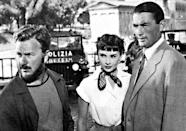 Audrey Hepburn with co-stars Eddie Albert(l)and Gregory Peck in a scene from 'Roman Holiday,' the film in which a Vespa also made a big impact