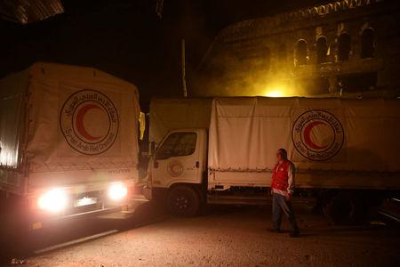 An aid convoy of food and medical supplies reaches the rebel-held besieged Syrian town of Douma, Damascus, Syria May 3, 2017. Picture taken May 3, 2017. REUTERS/Bassam Khabieh