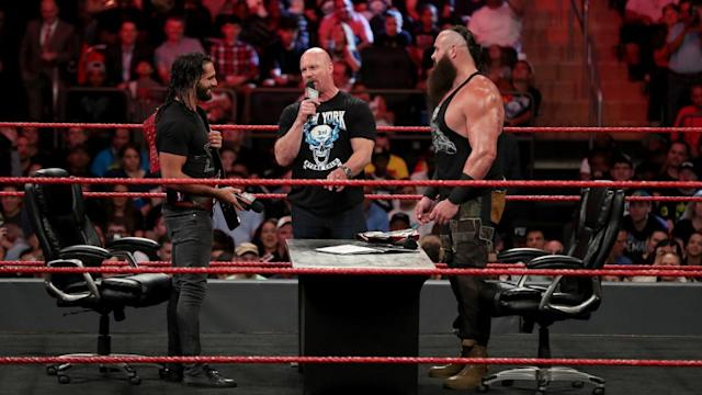 """""""Stone Cold"""" Steve Austin is seen on an episode of <em>Monday Night Raw</em> alongside Seth Rollins and Braun Strowman at Madison Square Garden. (Photo: WWE)"""