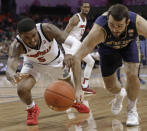 Louisville's Malik Williams (5) and Notre Dame's John Mooney (33) chase a loose ball during the first half of an NCAA college basketball game in the Atlantic Coast Conference tournament in Charlotte, N.C., Wednesday, March 13, 2019. (AP Photo/Chuck Burton)