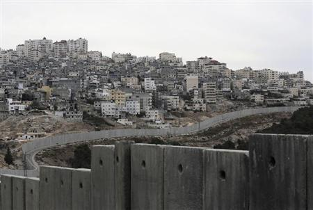 Israel's controversial barrier runs along the Shuafat refugee camp in the West Bank near Jerusalem