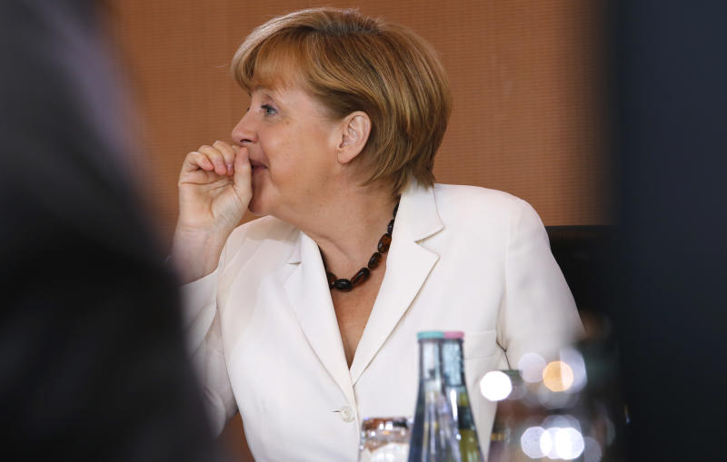 "FILE - In this July 10, 2013 file picture, German Chancellor Angela Merkel gestures prior to the weekly cabinet meeting in Berlin . Allegations of widespread U.S. data surveillance have created turbulence for Angela Merkel on what so far looked like a smooth cruise to a third term as German chancellor, even though it remains to be seen whether the flap will threaten her seriously. Merkel's center-left opponents have seized on disclosures of National Security Agency surveillance programs by leaker Edward Snowden to assert that she hasn't been doing enough to confront Washington and protect Germans' personal data - and to cast doubt on officials' assertions that they didn't know of the programs. The opposition apparently hopes that the issue will breathe life into a so-far stumbling and gaffe-prone campaign for Sept. 22 parliamentary elections. A healthy economy, low unemployment and perceptions that Merkel has managed Europe's debt crisis well have bolstered the chancellor. Merkel's center-left challenger, Peer Steinbrueck, is suggesting that the government turned a blind eye to violations of Germans' rights and that Merkel violated her oath of office, in which she swore to ""keep damage from"" her people. (AP Photo/Ferdinand Ostrop,File)"