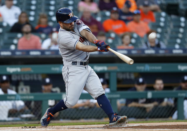 Houston Astros' Jose Altuve hits a leadoff solo home run against the Detroit Tigers in the first inning of a baseball game in Detroit, Tuesday, Sept. 11, 2018. (AP Photo/Paul Sancya)