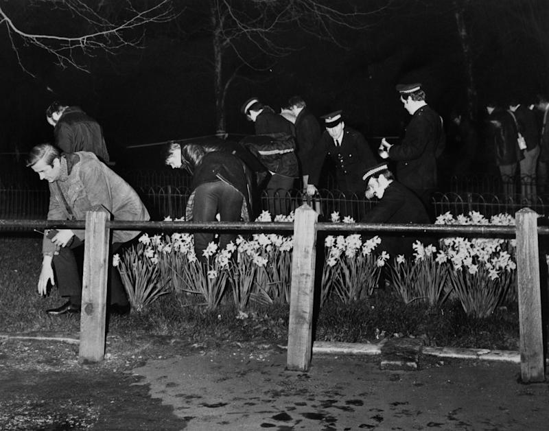 Police searching the scene of the crime in 1974 (Getty Images)