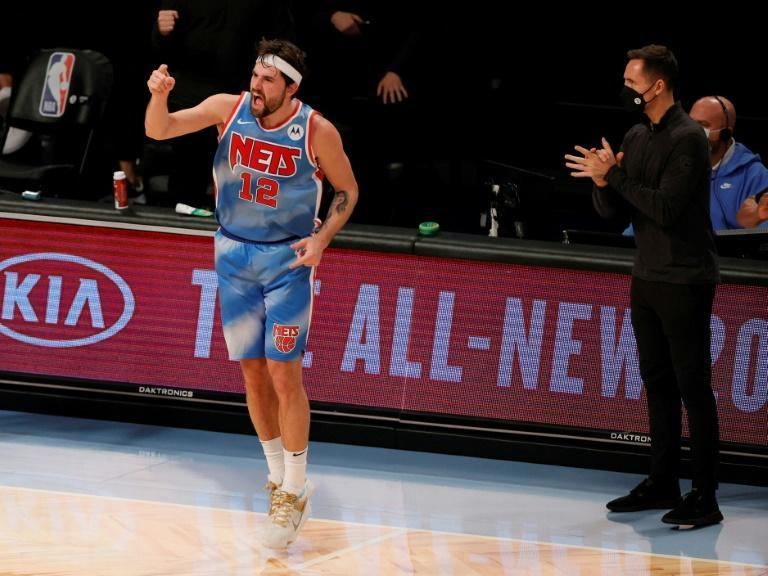 Brooklyn's Joe Harris celebrates after making a three-point basket as head coach Steve Nash applauds the shot during the Nets' 122-109 win over the Philadelphia 76ers at Barclays Center