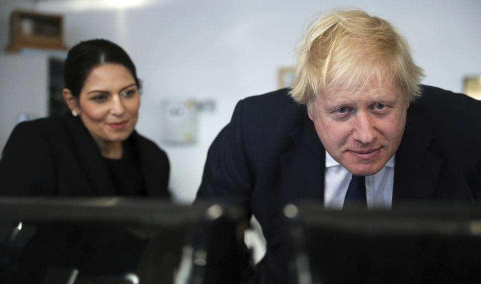 Britain's Prime Minister Boris Johnson and Home Secretary Priti Patel visit a security control room in Port of Southampton, England, Monday Dec. 2, 2019, ahead of the general election on Dec. 12. (Hannah McKay/Pool via AP)