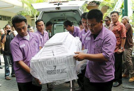 The body of Brazilian Rodrigo Gularte who was executed earlier arrives at a funeral home in Jakarta, Indonesia