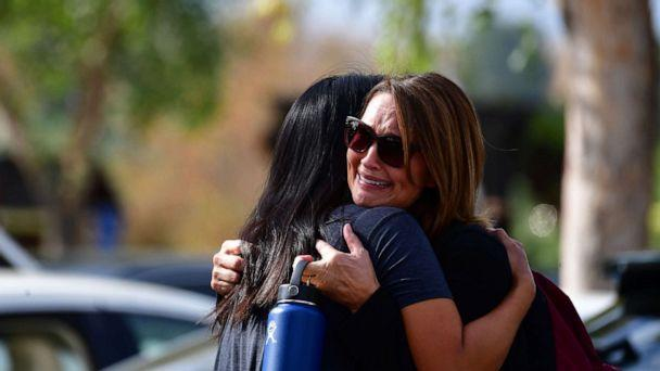 PHOTO: Women embrace in Central Park after a shooting at Saugus High School in Santa Clarita, California, Nov. 14, 2019. (Frederic J. Brown/AFP via Getty Images)