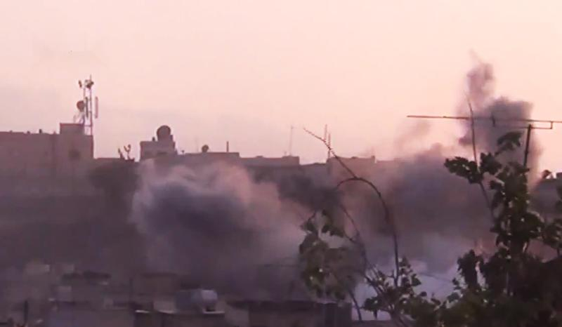 In this image made from amateur video released by the Shaam News Network and accessed Tuesday, June 26, 2012, smoke rises from buildings following purported shelling in Homs, Syria. (AP Photo/Shaam News Network via AP video) TV OUT, THE ASSOCIATED PRESS CANNOT INDEPENDENTLY VERIFY THE CONTENT, DATE, LOCATION OR AUTHENTICITY OF THIS MATERIAL