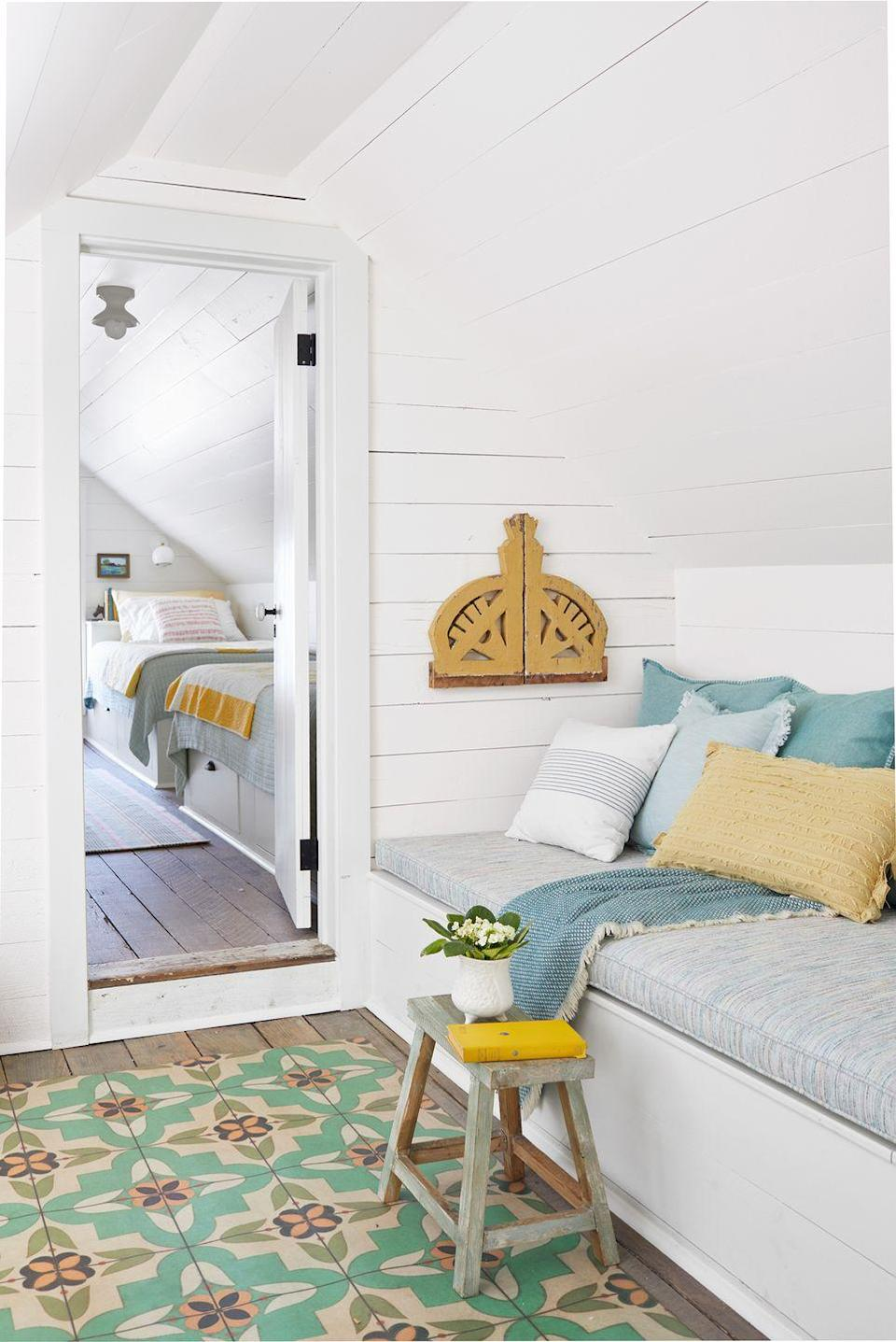 <p>Shiplap walls, painted white for a modern twist, lend a dose of farmhouse style to this inviting reading nook. </p>
