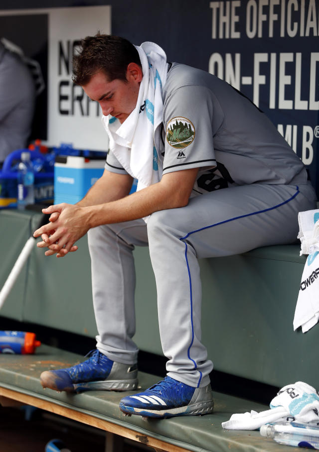 New York Mets relief pitcher Seth Lugo sits on the bench after allowing the tying run in the eighth inning of the first game of a baseball doubleheader against the Atlanta Braves, Monday, May 28, 2018, in Atlanta. (AP Photo/John Bazemore)