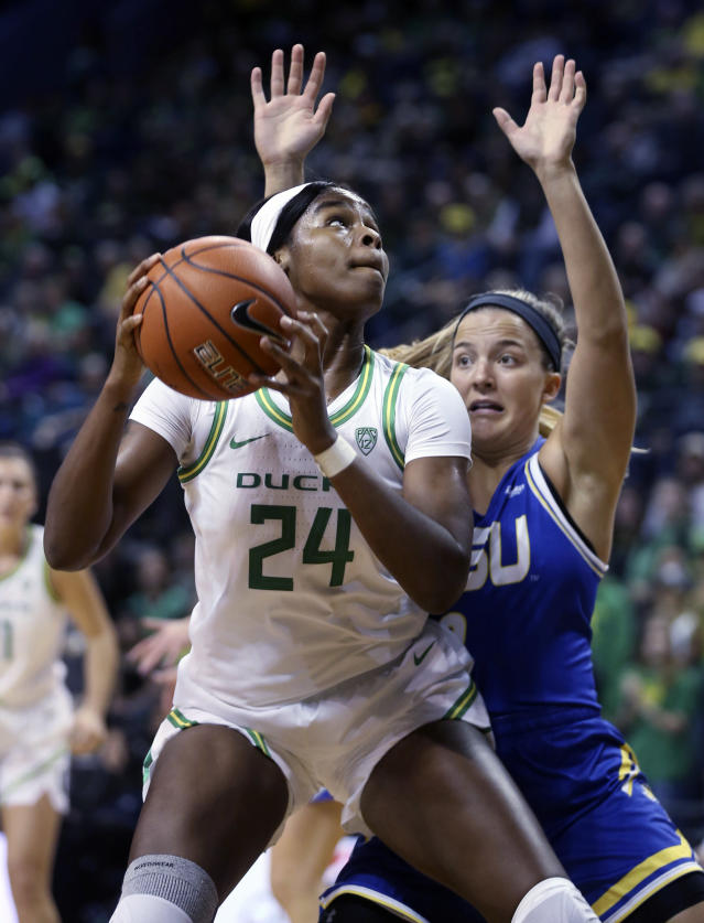 Oregon's Ruthy Hebard, left, works for position against South Dakota State's Lindsey Theuninck during the first quarter of a NCAA college basketball game in Eugene, Ore., Sunday, Dec. 8, 2019. (AP Photo/Chris Pietsch)