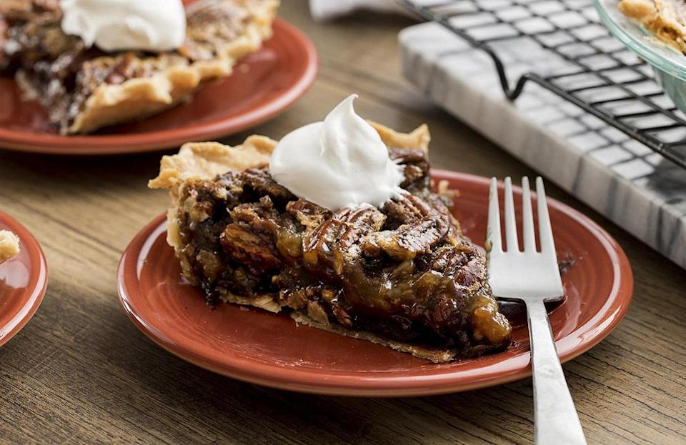 """<p>Pecan pie is <a href=""""https://www.thedailymeal.com/eat/most-iconic-food-every-state-gallery?referrer=yahoo&category=beauty_food&include_utm=1&utm_medium=referral&utm_source=yahoo&utm_campaign=feed"""" rel=""""nofollow noopener"""" target=""""_blank"""" data-ylk=""""slk:an iconic state food"""" class=""""link rapid-noclick-resp"""">an iconic state food</a>, and it's always fun to put a twist on classic recipes. This recipe adds a favorite sweet ingredient: chocolate.</p> <p><a href=""""https://www.thedailymeal.com/recipes/decadent-chocolate-pecan-pie-recipe-0?referrer=yahoo&category=beauty_food&include_utm=1&utm_medium=referral&utm_source=yahoo&utm_campaign=feed"""" rel=""""nofollow noopener"""" target=""""_blank"""" data-ylk=""""slk:For the Chocolate Pecan Pie recipe, click here."""" class=""""link rapid-noclick-resp"""">For the Chocolate Pecan Pie recipe, click here.</a></p>"""