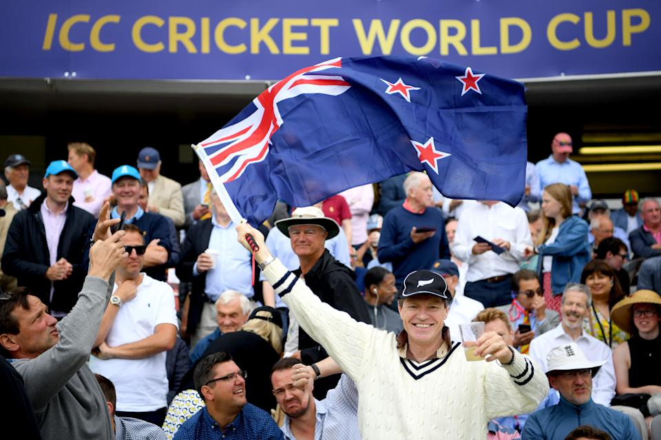 A New Zealand fan supports his team from the stands. (Photo by Clive Mason/Getty Images)