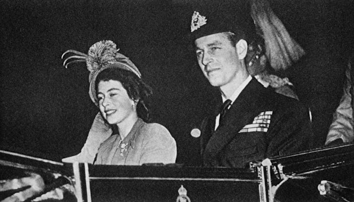 """<p>Wondering how these two have been together for a staggering 70+ years? It's because they met when they were very young...and the story is quite adorable. The Queen once wrote a letter about the time she met Prince Philip, then Philip Mountbatten. She wrote that the two of them first met at the Royal Naval College in July 1939, when she was just 13-years-old. She quickly fell for 18-year-old Philip, who was a naval cadet at the time. </p><p>Apparently, Philip was keeping Elizabeth and her sister company and supposedly impressed Elizabeth by jumping over tennis nets. He joined them the following day on their family yacht (Victoria and Albert), where Elizabeth <a href=""""https://parade.com/725819/beckyhughes/prince-philip-says-queen-elizabeth-was-so-shy-when-they-first-met-80-years-ago/"""" rel=""""nofollow noopener"""" target=""""_blank"""" data-ylk=""""slk:reportedly"""" class=""""link rapid-noclick-resp"""">reportedly</a> couldn't take her eyes off of him.</p>"""