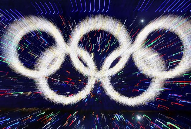 BEIJING - AUGUST 08:  The Olympic rings are illuminated during the Opening Ceremony for the 2008 Beijing Summer Olympics at the National Stadium on August 8, 2008 in Beijing, China.  (Photo by Alexander Hassenstein/Bongarts/Getty Images)