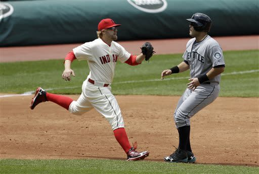 Cleveland Indians' Mark Reynolds, left, tags out Seattle Mariners' Jesus Montero as Montero is caught stealing in the third inning of a baseball game, Saturday, May 18, 2013, in Cleveland. (AP Photo/Tony Dejak)