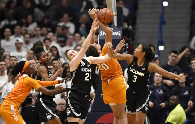 Connecticut's Anna Makurat (24) and Connecticut's Megan Walker (3) fight for a rebound with Tennessee's Tamari Key (20) in the second half of an NCAA college basketball game, Thursday, Jan. 23, 2020, in Hartford, Conn. (AP Photo/Jessica Hill)