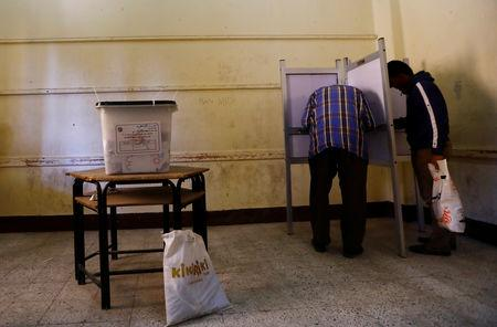 Voters fill in their ballots during the second day of the referendum on draft constitutional amendments, at a polling station in Cairo, Egypt April 21, 2019. REUTERS/Amr Abdallah Dalsh