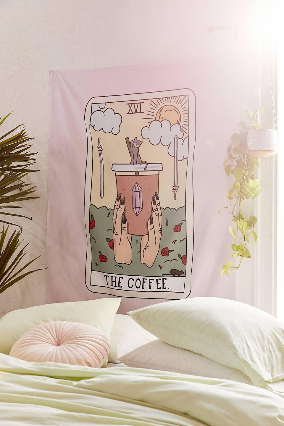 """<p><strong>Deny Designs</strong></p><p>urbanoutfitters.com</p><p><strong>$49.00</strong></p><p><a href=""""https://go.redirectingat.com?id=74968X1596630&url=https%3A%2F%2Fwww.urbanoutfitters.com%2Fshop%2Fsage-pizza-for-deny-coffee-reading-tapestry&sref=https%3A%2F%2Fwww.delish.com%2Fholiday-recipes%2Fchristmas%2Fg3132%2Fgift-coffee-obsessed%2F"""" rel=""""nofollow noopener"""" target=""""_blank"""" data-ylk=""""slk:BUY NOW"""" class=""""link rapid-noclick-resp"""">BUY NOW</a></p><p>We see a pipin' hot cup of coffee in your future... </p>"""