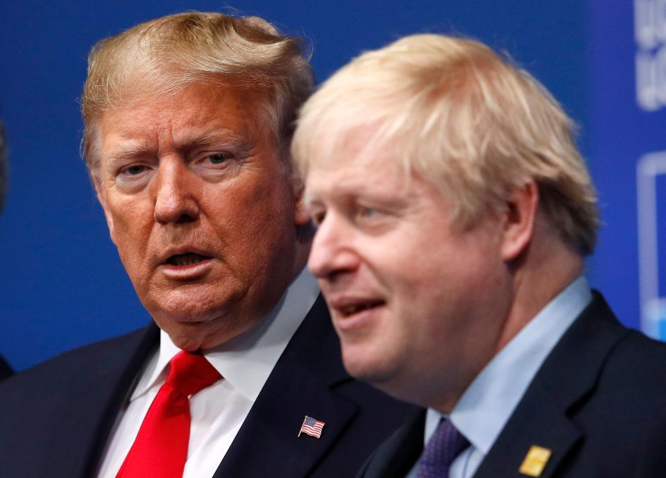 Britain's Prime Minister Boris Johnson (R) welcomes US President Donald Trump (L) to the NATO summit at the Grove hotel in Watford, northeast of London on December 4, 2019. (Photo by PETER NICHOLLS / various sources / AFP) (Photo by PETER NICHOLLS/AFP via Getty Images)