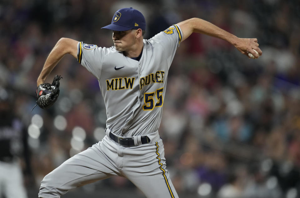 Milwaukee Brewers relief pitcher Hoby Milner works against the Colorado Rockies during the sixth inning of a baseball game Thursday, June 17, 2021, in Denver. (AP Photo/David Zalubowski)
