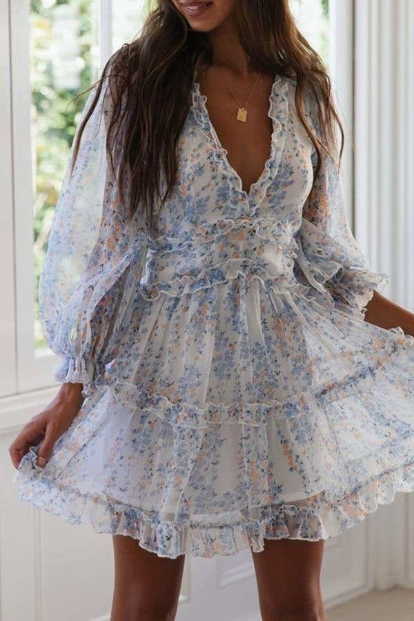 """You can shake off those winter blues when you put this on and fully subscribe to spring-ready glamour in the form of a ruffly silhouette that'll have you twirling from now 'til the end of summer.<br /><br /><strong>Promising review:</strong>""""Such a cute spring dress. Love the balloon sleeves! The floral pattern is small and very flattering. It's a great length as well and very comfy."""" —<a href=""""https://www.amazon.com/gp/customer-reviews/R36LBZNGB11RWB?&linkCode=ll2&tag=huffpost-bfsyndication-20&linkId=517e4e132e02ce1ce233cce23ffded1f&language=en_US&ref_=as_li_ss_tl"""" target=""""_blank"""" rel=""""nofollow noopener noreferrer"""" data-skimlinks-tracking=""""5925990"""" data-vars-affiliate=""""Amazon"""" data-vars-href=""""https://www.amazon.com/gp/customer-reviews/R36LBZNGB11RWB?tag=bfjasminsandal-20&ascsubtag=5925990%2C5%2C36%2Cmobile_web%2C0%2C0%2C16629643"""" data-vars-keywords=""""cleaning,fast fashion"""" data-vars-link-id=""""16629643"""" data-vars-price="""""""" data-vars-product-id=""""21071678"""" data-vars-product-img="""""""" data-vars-product-title="""""""" data-vars-retailers=""""Amazon"""">Jamila</a><br /><br /><strong><a href=""""https://www.amazon.com/Dokotoo-Womens-Spring-Summer-Ruffle/dp/B091DYF835?&linkCode=ll1&tag=huffpost-bfsyndication-20&linkId=0a411c3fa6d0dbef9d7258261a241ab5&language=en_US&ref_=as_li_ss_tl"""" target=""""_blank"""" rel=""""noopener noreferrer"""">Get it from Amazon for$13.98+(available in sizes S–XL and in 30 colors and styles).</a></strong>"""