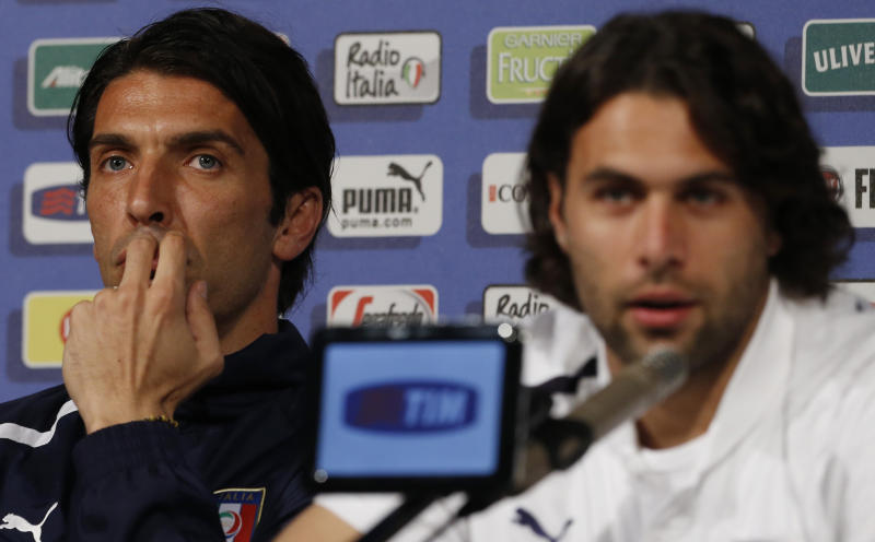 Italy goalkeeper Gianluigi Buffon, left, and teammate Salvatore Sirigu meet journalists prior to the start of a training session in Krakow, Poland, Friday, June 22, 2012. Italy will play England in a Euro 2012 quarterfinal soccer match on Sunday in Ukraine. (AP Photo/Gregorio Borgia)