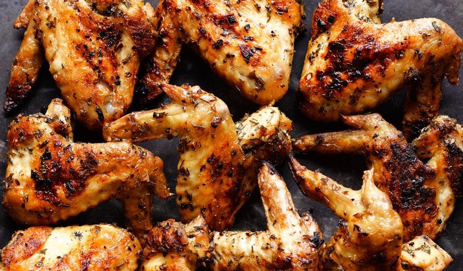 """The seductively high ratio of skin to meat is what makes wings taste good, and grilling takes full advantage of that. This herb marinade is bright and summery, and light enough to let the skin get nice and crisp. Watch the video here. <a href=""""https://www.bonappetit.com/recipe/herbed-grilled-chicken-wings?mbid=synd_yahoo_rss"""" rel=""""nofollow noopener"""" target=""""_blank"""" data-ylk=""""slk:See recipe."""" class=""""link rapid-noclick-resp"""">See recipe.</a>"""
