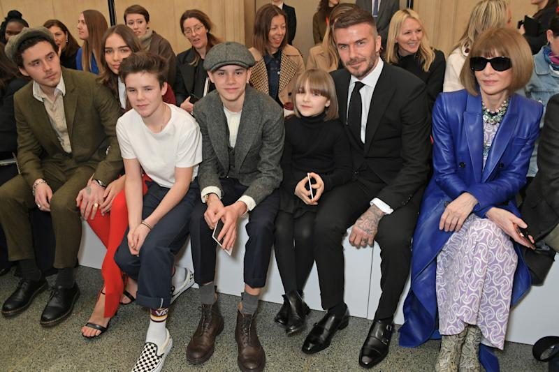 The Beckham children join their father (and Anna Wintour) to cheer on Victoria Beckham [Photo: Getty]