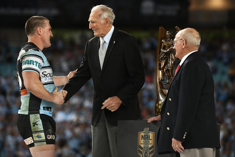 Pictured here, Sharks captain Paul Gallen shakes hands with Norm Provan (L) after winning the 2016 NRL grand final.