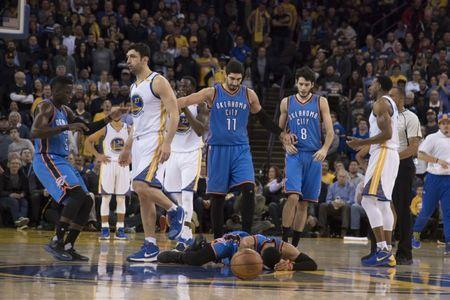 January 18, 2017; Oakland, CA, USA; Golden State Warriors center Zaza Pachulia (27) fouls Oklahoma City Thunder guard Russell Westbrook (0) receiving a flagrant foul during the second quarter at Oracle Arena. Mandatory Credit: Kyle Terada-USA TODAY Sports