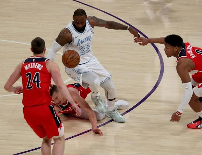 LOS ANGELES, CALIF. - FEB. 212, 2021. Lakers forward LeBron James fights for control.