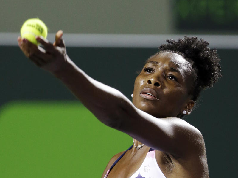 Venus Williams serves to Kimiko Date-Krumm, of Japan, during the Sony Open tennis tournament, Thursday, March 21, 2013, in Key Biscayne, Fla. (AP Photo/Wilfredo Lee)