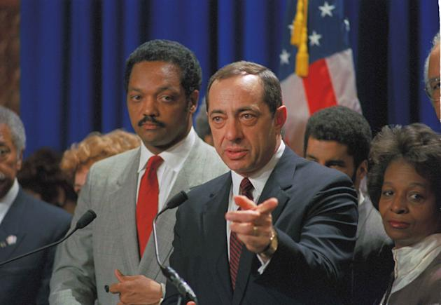 CLICK IMAGE for slideshow. New York Gov. Mario Cuomo points to a reporter at the Capitol in Albany, N.Y. during a news conference with the Rev. Jesse Jackson, April 13, 1988. . (AP Photo/Jim McKnight)