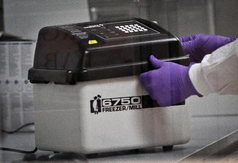 In this April 15, 2014 photo, a person demonstrates how to use a device used for milling and extracting DNA, at the Office of Chief Medical Examiner in New York. With new technology yielding results impossible a dozen years ago, forensic scientists are still trying to match the bone with DNA from those who died on Sept. 11, 2001, and have never been identified. (AP Photo/Bebeto Matthews)