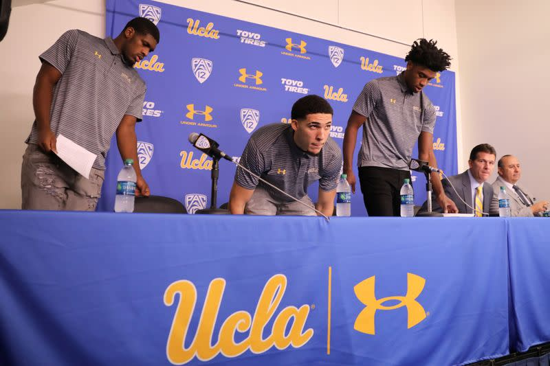 UCLA basketball players Cody Riley, LiAngelo Ball, and Jalen Hill arrive to speak at a press conference at UCLA after flying back from China where they were detained on suspicion of shoplifting, in Los Angeles